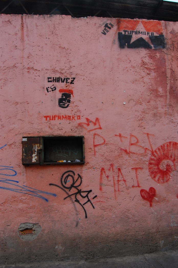 Stencil graffiti on a wall in Catia that declares Hugo Chávez a Tupamaro, one of the most well recognized collectives in Caracas. © Rebecca Hanson 2014