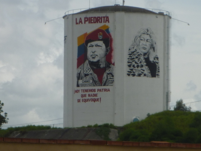 A water tower in Catia with Hugo Chávez's face on one side and the face of Lina Ron (founder of the Venezuelan Popular Union party and symbol of La Piedrita, another well known collective) on the other © Richard Snyder 2014