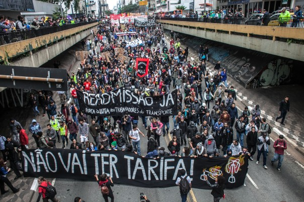 """A June 19, 2014 São Paulo protest called by the Movimento Passe Livre (Free Fare Movement) to protest transport fares and conditions, but mischaracterized internationally as an """"Antigovernment"""" and """"World Cup"""" protest. The banner in front reads, """"There will be no fare."""" Photo. Oliver Kornblihtt/ Midia NINJA"""