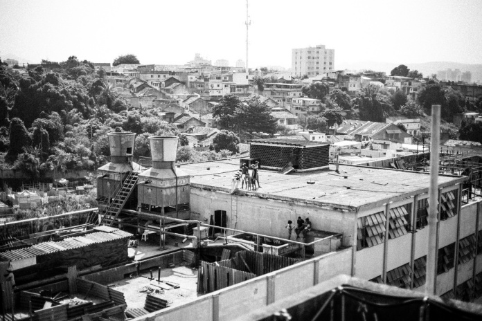 The TELERJ favela was founded by 5,000 people in a set of abandoned buildings a few miles from Maracanã stadium in Rio de Janeiro, in March 2014. They were forcibly evicted by the government in April. Photo courtesy of Mídia NINJA CC BY-NC-SA 2.0