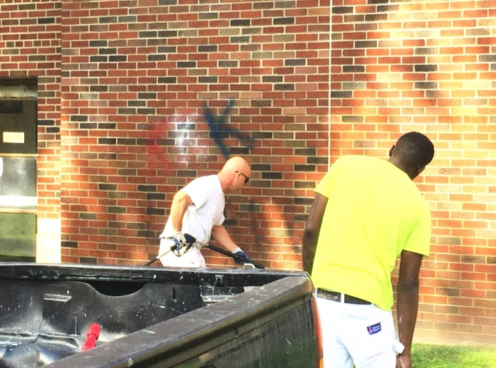 On Tuesday Sept. 20, around 9 a.m. graffiti was found on the outer wall of EMU's King Hall depicting hate speech. Picture taken after some writing was removed. (photo credit: Shayler Barnes Jr. / The Eastern Echo)